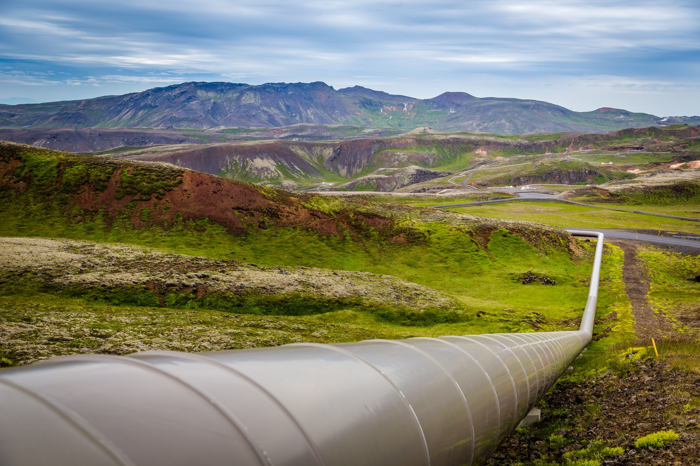 An oil and gas pipeline going through the mountains.
